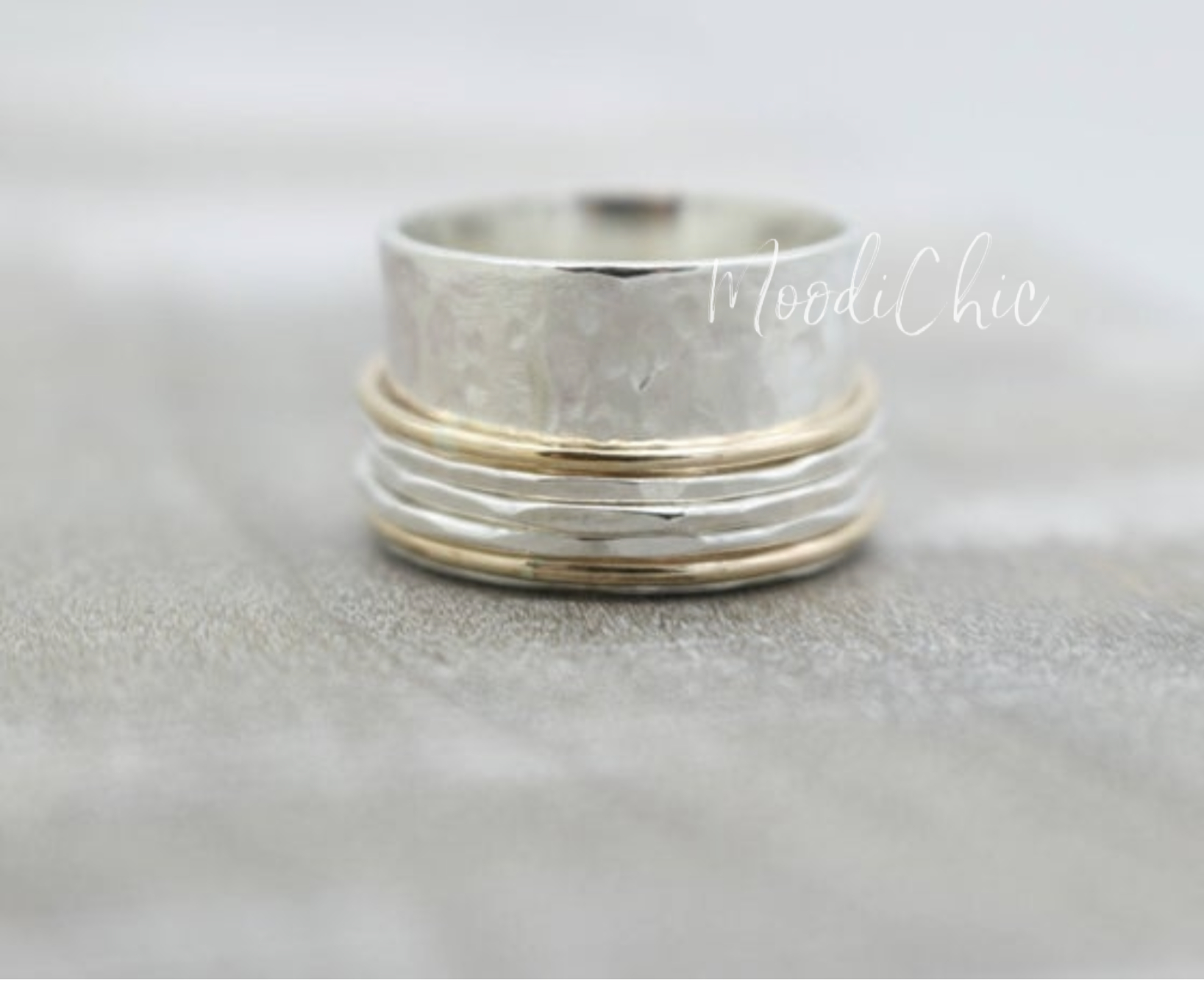Sterling silver and gold spinner ring
