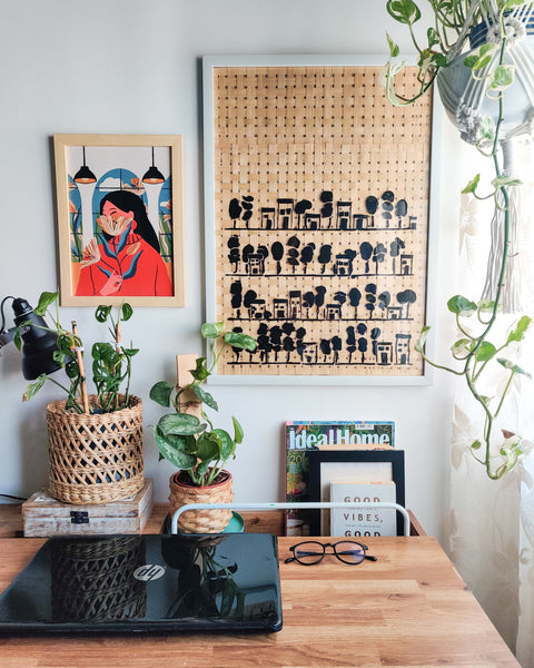 Work table with stenciled art on bamboo mat frame on the wall