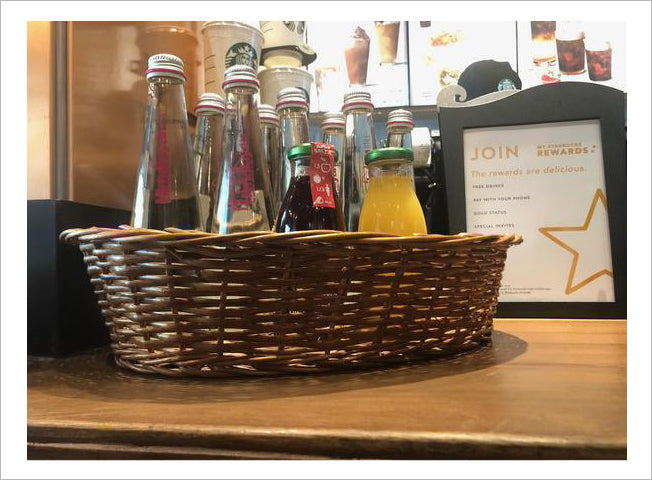 Wicker basket for bottles display at Starbucks