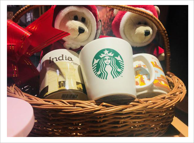 Gift hamper display in wicker basket at Starbucks