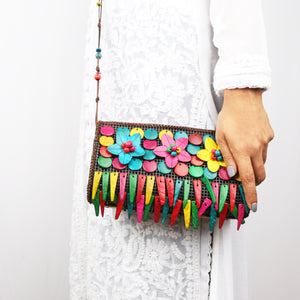 DAISYLIFE Natural and Eco-friendly Colorful Coconut Shell fringe spacious sling bag for party or casual occasion wear.