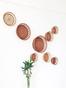 Natural round wicker baskets used for wall installation/ wall décor.