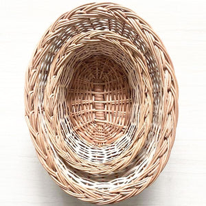 Natural oval set of two wicker baskets top view