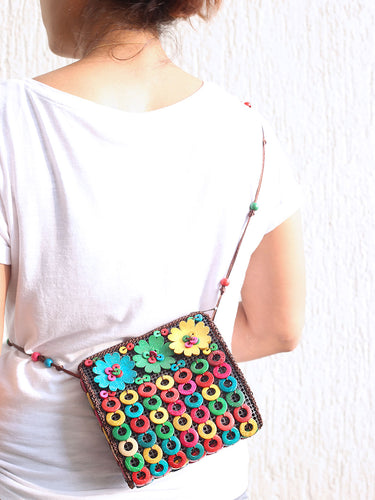 DaisyLife natural coconut shell multicolor floral fashion sling bag on model