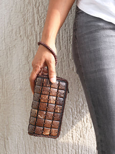 DaisyLife natural coconut shell cubes clutch wristlet bag on model