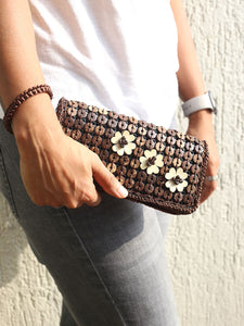 DaisyLife natural coconut shell brown wristlet clutch bag on model