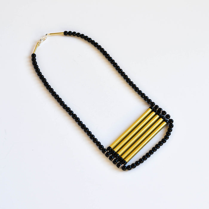 Handmade black onyx necklace with brass bars