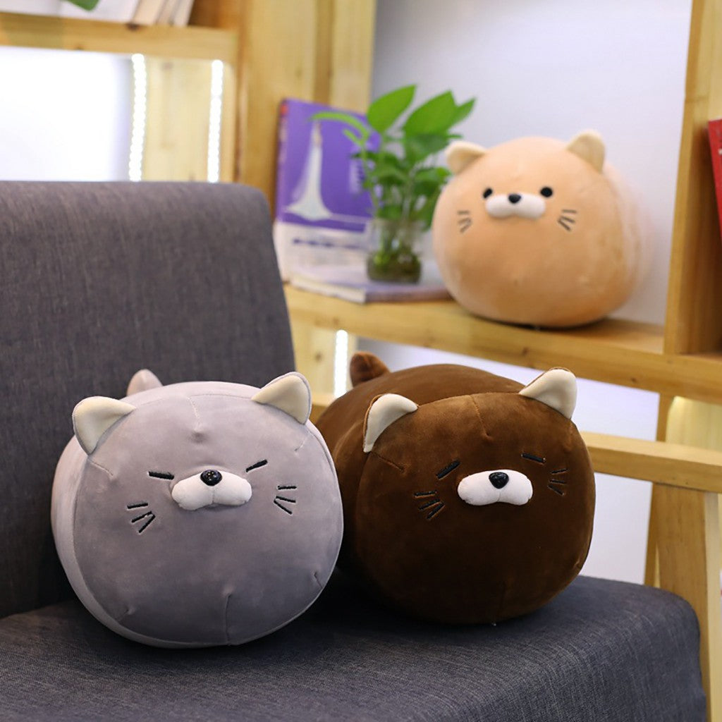Kawaii-grey-brown-and-blonde-anime-kitten-plush-pillows-on-grey-couch