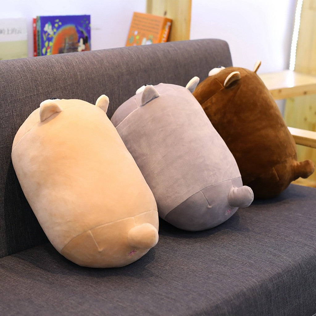 Kawaii-blonde-grey-and-brown-anime-kitten-plush-pillows-on-grey-couch