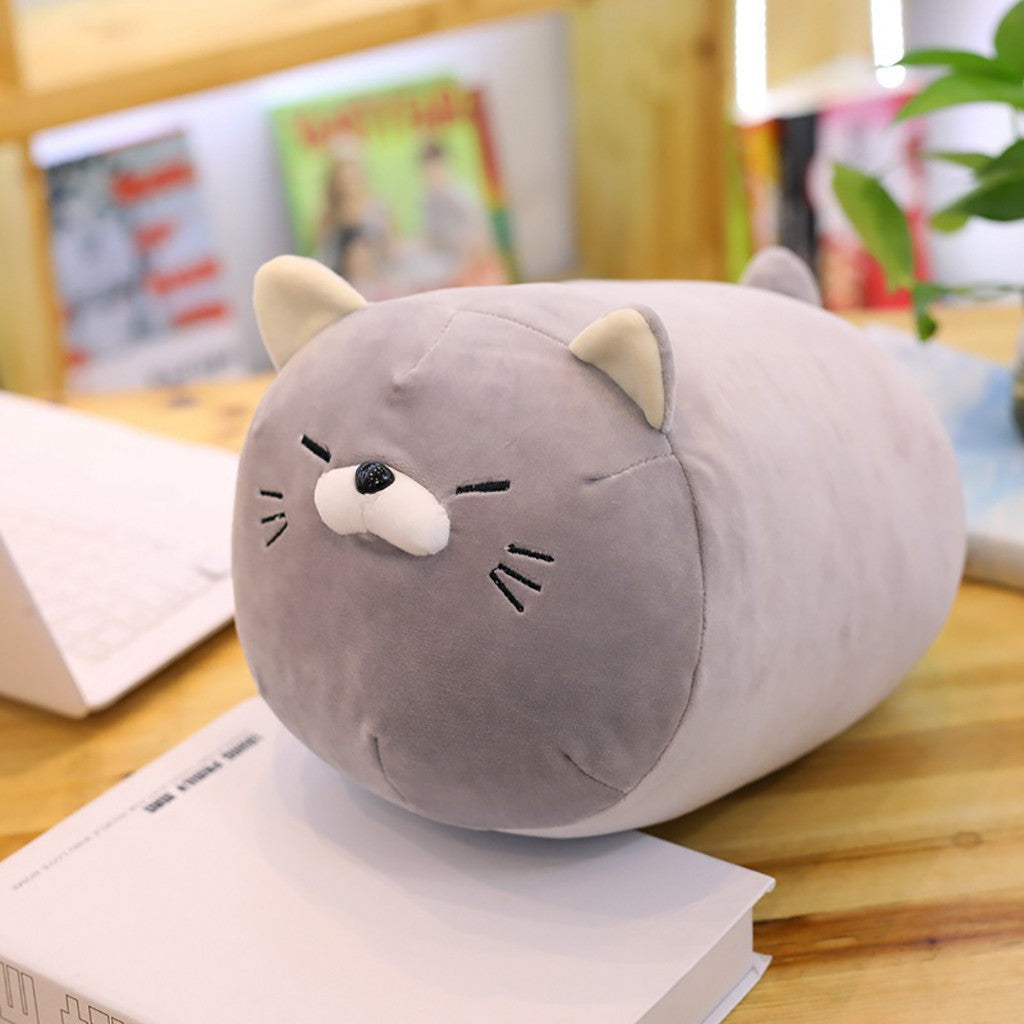 Kawaii-grey-sleepy-adorable-anime-kitten-plush-pillow-on-desk