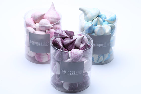 A three-box set of fleurs délices™ meringues: blueberry lavender, raspberry rose, and orange blossom.