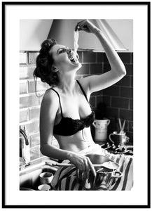 Woman in kitchen posters