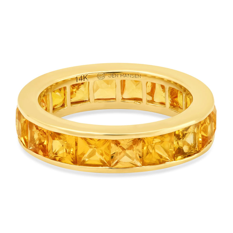 LARGE YELLOW SAPPHIRE CHANNEL SET RING, GOLD
