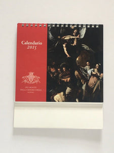 Calendar 2015 from church Pio Mont Della Misericordia, Naples showing 'The Works of Mercy' by Caravaggio
