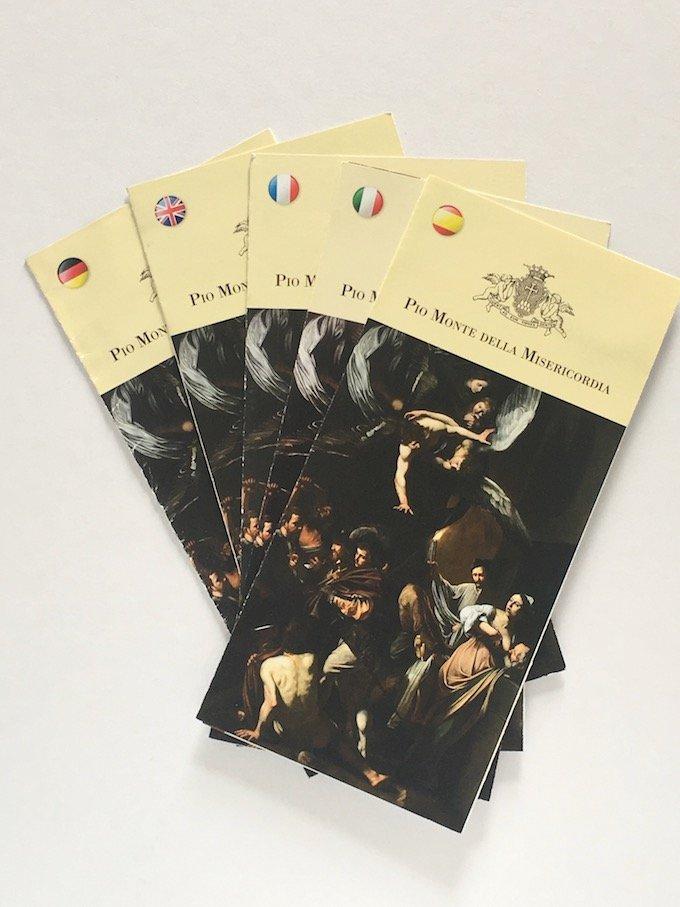 Brochures from the church Pio Mont Della Misericordia, Naples containing The Works of Mercy by Caravaggio
