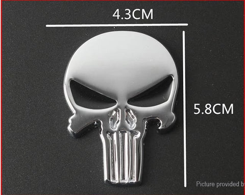 Image of Silver-colored 3D metallic skull auto decal with black eyes.