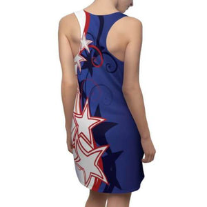 Rear view of woman wearing Patriotic Stylized Shooting Stars Racerback Dress with highly-styled red and white shooting stars and swirls against a blue field.