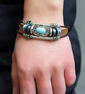Front view image of a person wearing Brown Vintage Turquoise Woven Tri-Strap Leather Bracelet for men