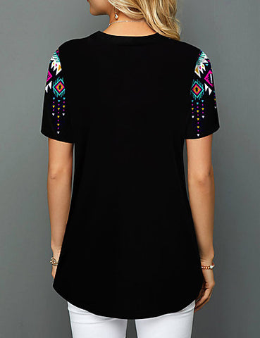 Back view of a black women's multi-color geometric blouse when worn.