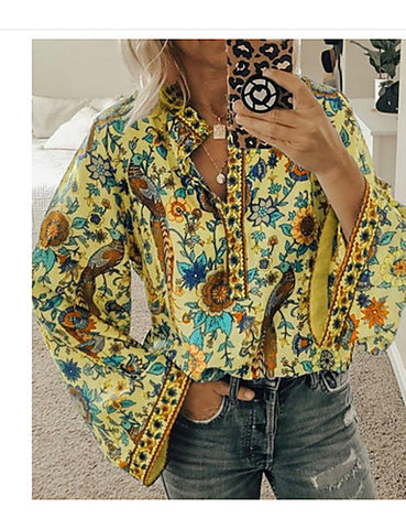 Front view of a yellow women's boho shirt when worn.