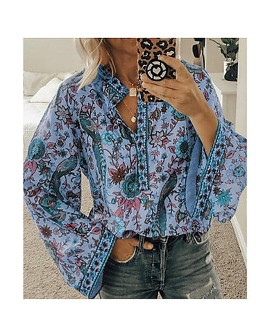 Front view of a blue women's boho shirt when worn.