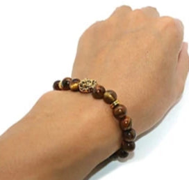 Picture of a unisex bead lion bracelet when worn.