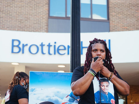 Dannielle Brown speaking to Duquesne University student body outside Brottier Hall. Image taken from Google Images