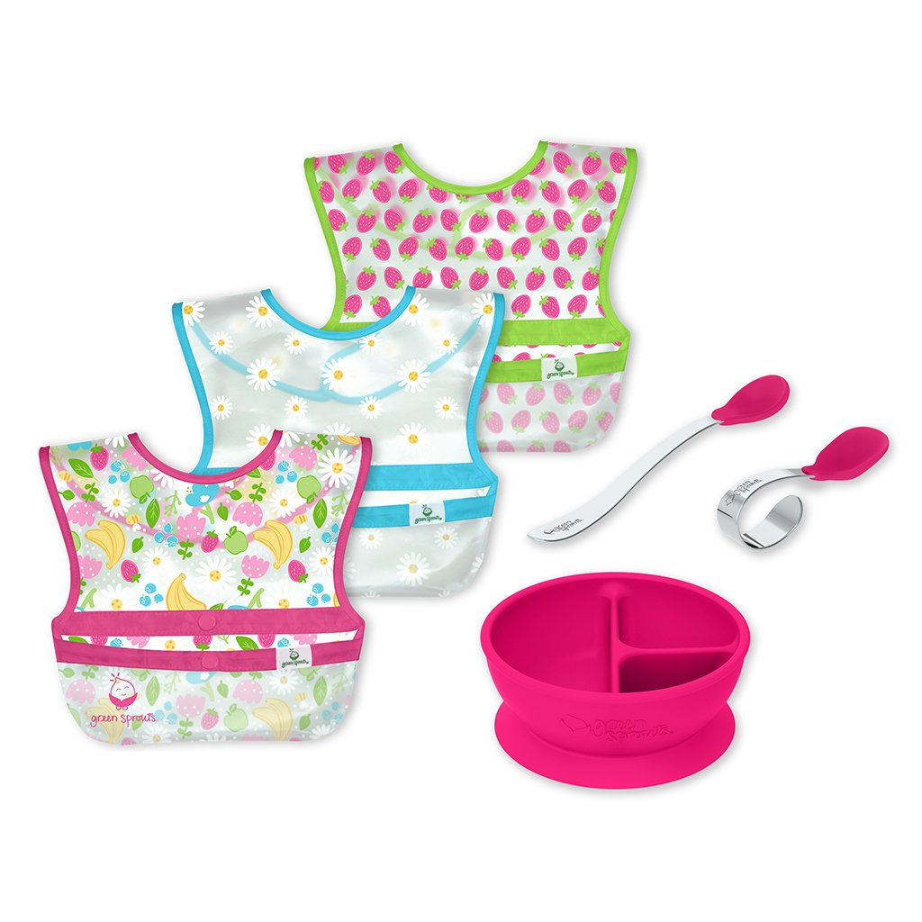 Baby Mealtime Learning Set with the three pink patterned wipe-off bibs, pink learning bowl with suction base, and the pink learning spoon set.
