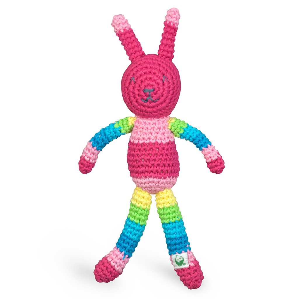 A pink and striped rainbow patterned rattle crocheted to look like a rabbit.