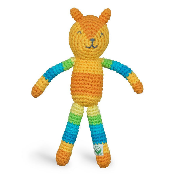 An orange and striped rainbow patterned rattle crocheted to look like a fox.