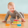 A cute toddler boy with a gray Long Sleeve Adjustable Bodysuit made from Organic Cotton on playing with some toys
