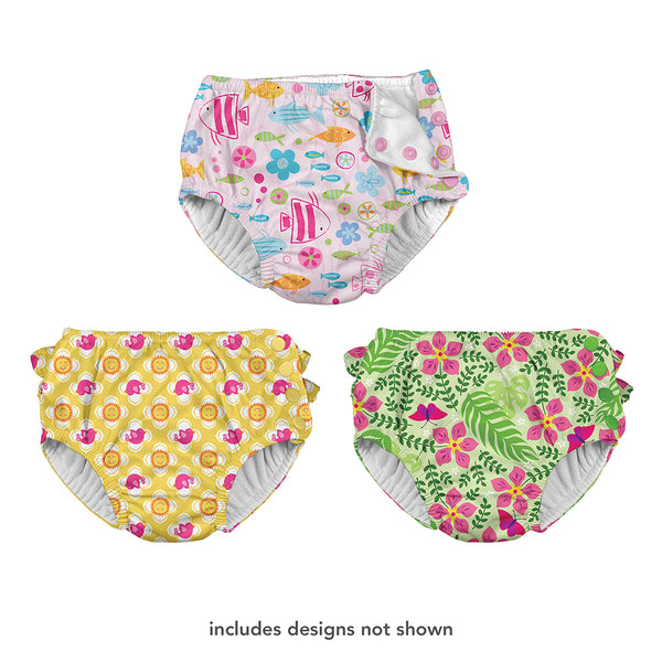 "Three different swim diapers that one shows a girly school of fish pattern, the other is a sun and bird pattern, and the last one is a tropical flower pattern. At the bottom is says ""includes designs not shown""."