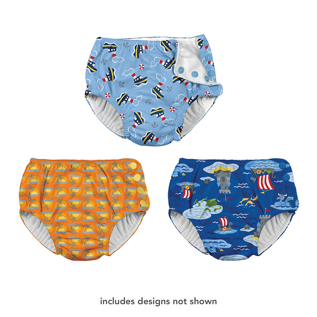 "Three different swim diapers that one shows a tug boat pattern, the other is a cartoon sunset, and the last one is a castle with a viking boat pattern. At the bottom is says ""includes designs not shown""."