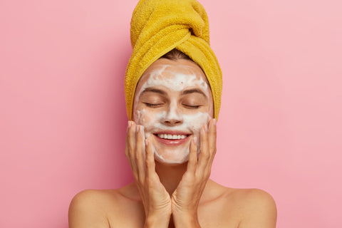 Women Cleansing her Face