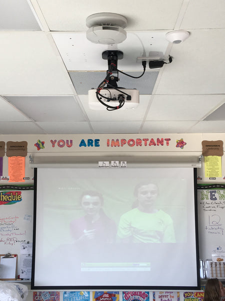 Isle of Wight County School uses RTSP streaming for morning announcements, projected onto classroom wall.