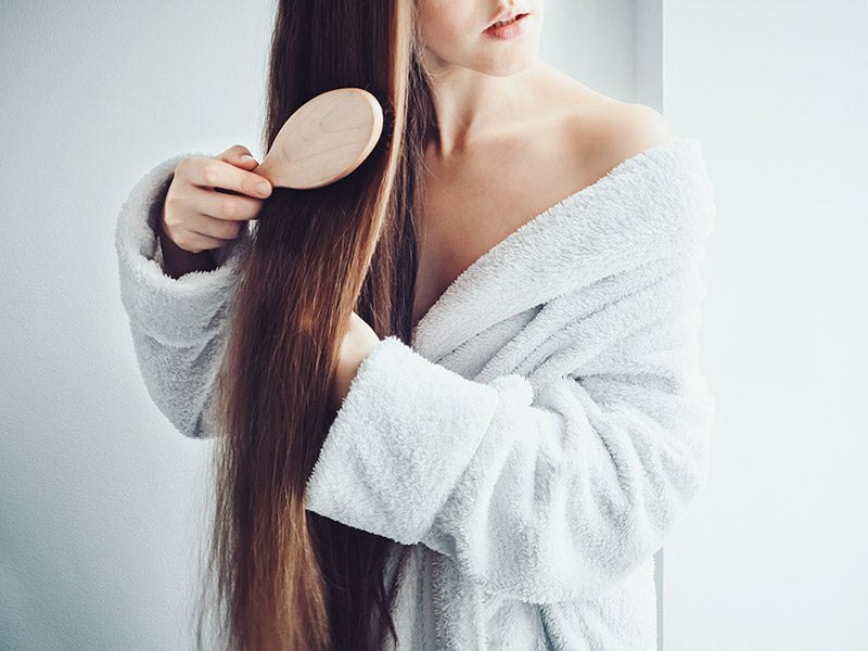 Girl Brushing Hair - Brush CBD Oil Through Hair