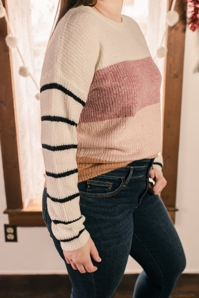 Ivory sweater with pink block sweater and black lines