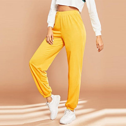 YELLOW ELASTIC WAIST TAPERED CARROT PANTS-Cosmique Studio