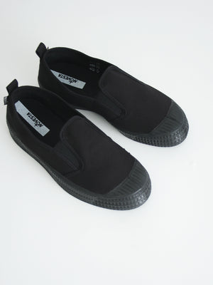 Slip-on canvas sneakers, all black