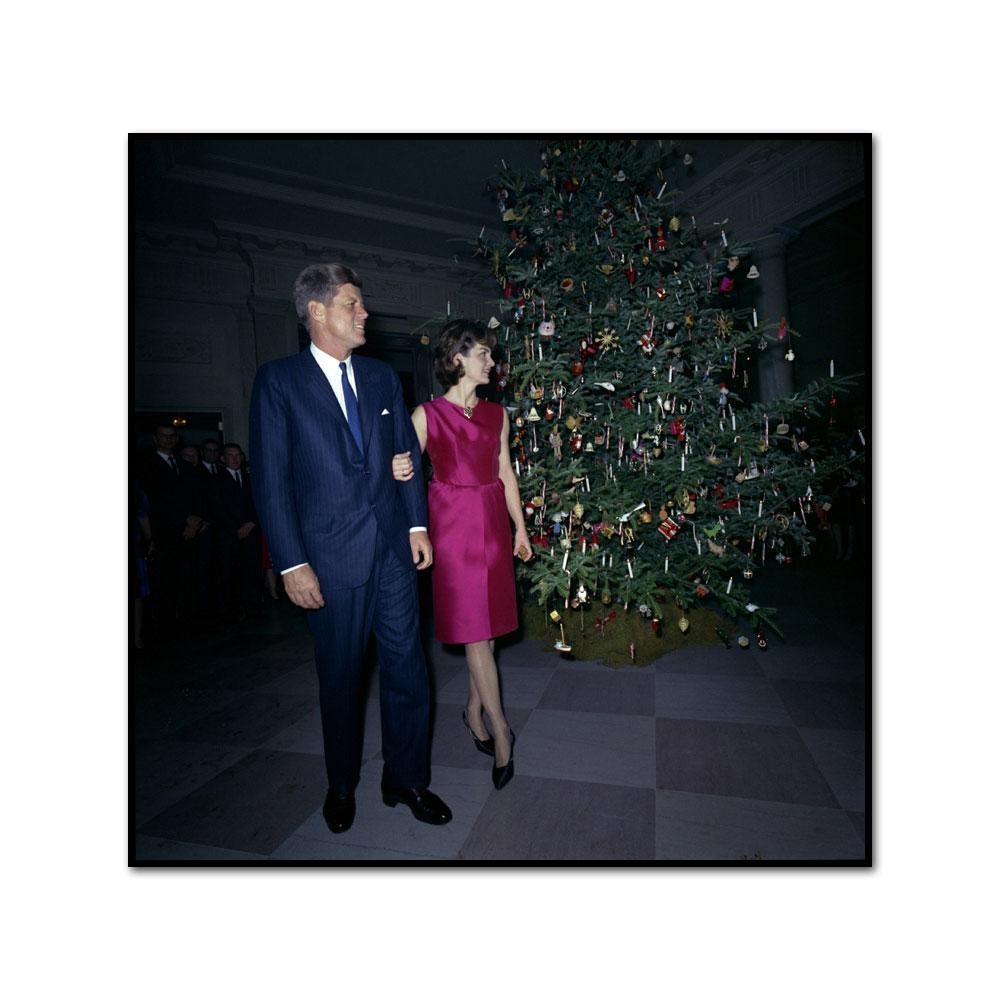 President and Mrs. Kennedy at the White House Staff Christmas Party