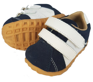Navy sneaker with white trim.  Double hook and loop fastening.