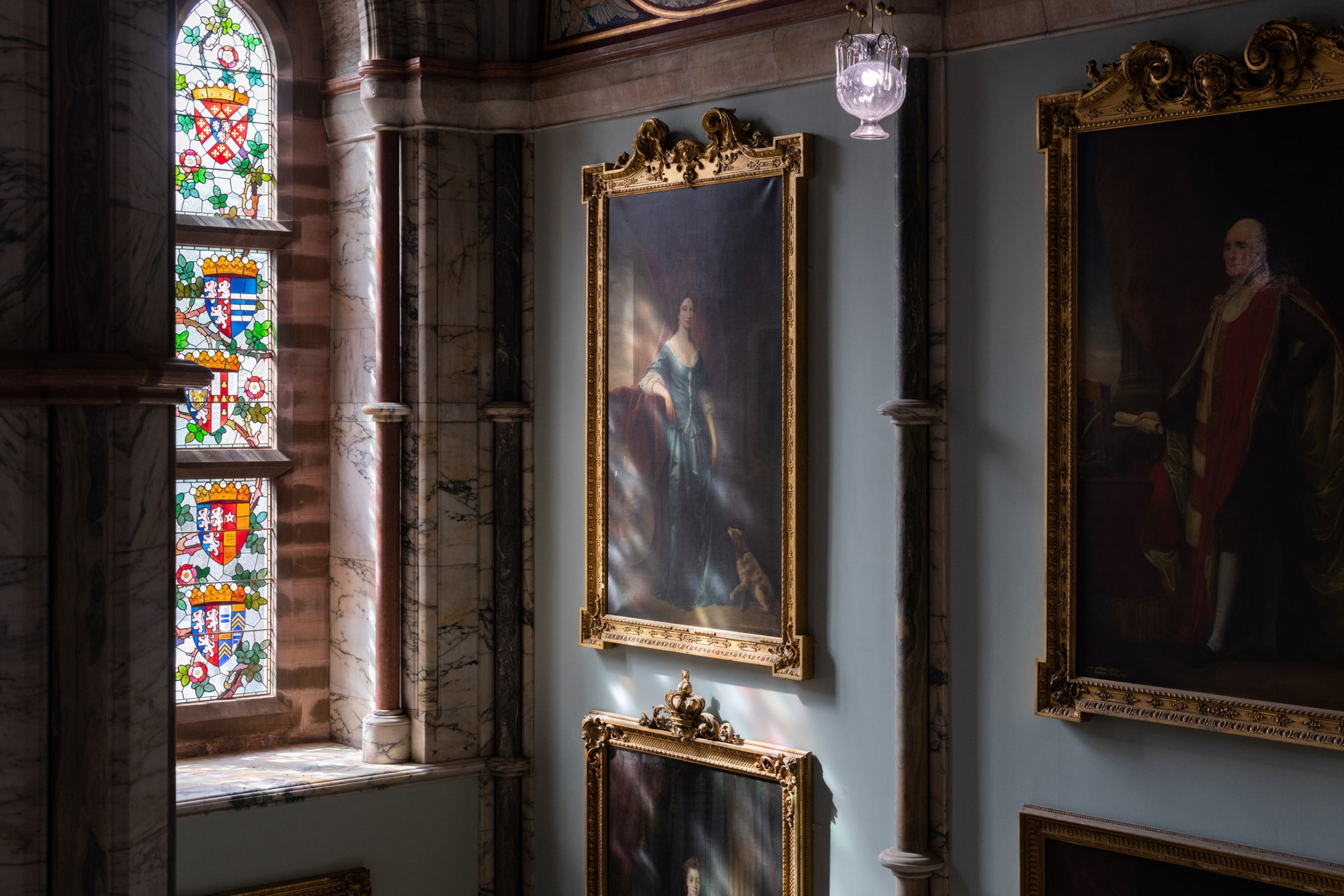 Art hanging on the walls inside Mount Stuart