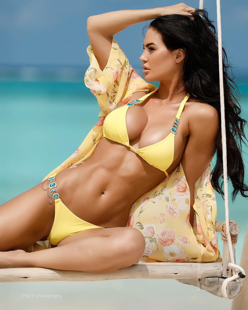 Katelyn Runck in the yellow bikini with blue gems