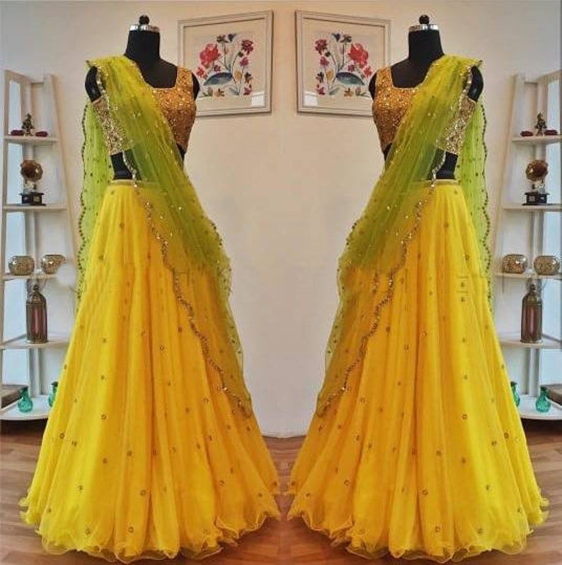 Imaginary Yellow Color Net With Embrodery Lehenga Choli