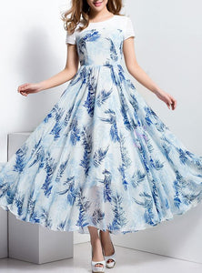 Evergreen White And Blue Color Digital Printed Floral Gown