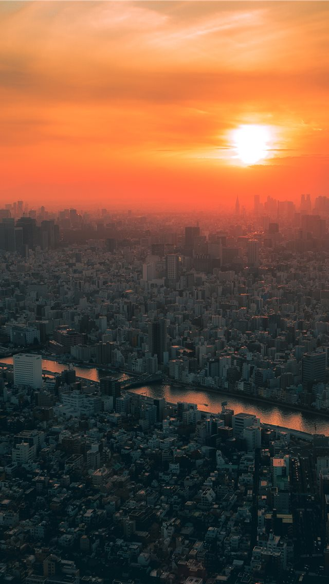 Aerial Photography Of City During Golden Hour iPhone XS Wallpaper