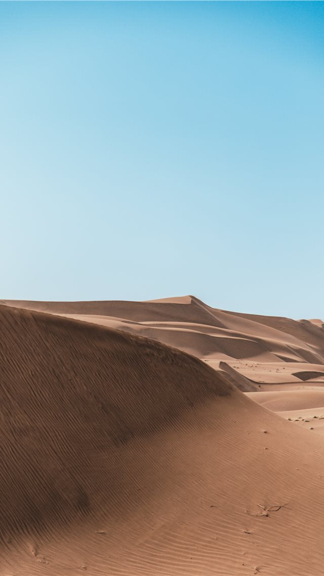 Brown Sand Under White Cloudy Sky iPhone 11 Wallpaper