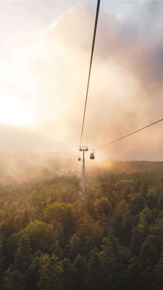 Cable Car Under Brown And White Sky iPhone 11 Wallpaper
