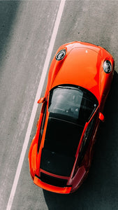 orange vehicle on road close up photography iPhone 11 HD wallpaper