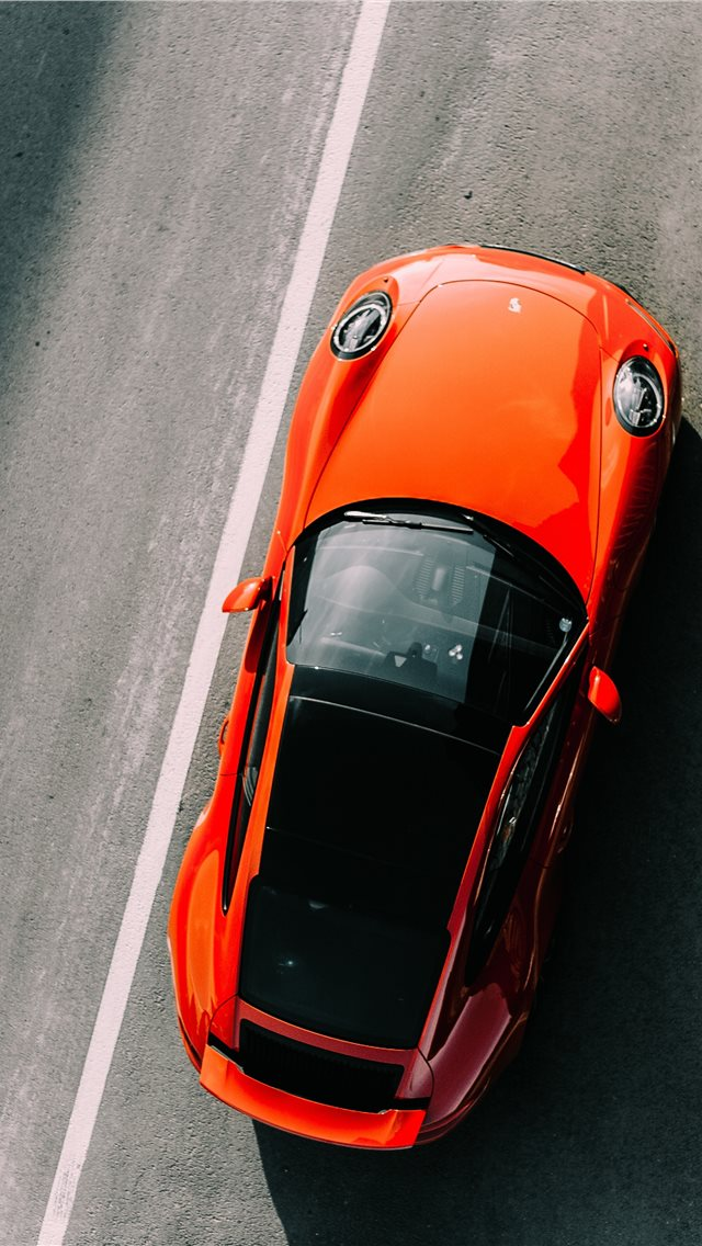 Orange Vehicle On Road Close Up Photography iPhone XS Wallpaper